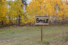 Smile sign. With fall colored trees Royalty Free Stock Photo