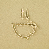 Smile sign on a sand Royalty Free Stock Photos