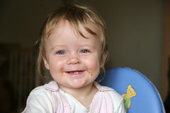 Smile in smear baby face. Smile in baby face little smear after bread eating Stock Image