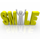 Smile - Smiley Man in Word. The word Smile in yellow letters and a man with a smiley face stands in for the letter i Royalty Free Stock Photo
