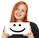 Smile. Smiling young woman holding up white banner Royalty Free Stock Photos