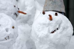 Smile of the snowman. Snowballs-traditional a winter entertainment Stock Images