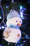 Smile Snowman. A snowman on the Christmas tree Stock Images