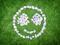 Smile stones grass background Stock Photos