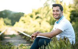 Smile student or man sitting in nature Stock Images