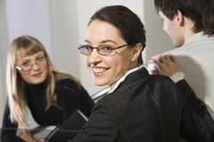 Smile of success. Portrait of smiling businesswoman in the company of business associates Stock Photography