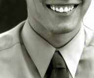 Smile of success. Black and white image of a business man royalty free stock photography