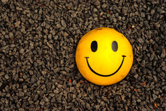 Smile. Symbol on gravel background Royalty Free Stock Image