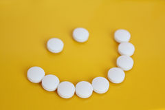 Smile from tablets Stock Photo