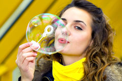 Smile teen blowing soap bubbles Royalty Free Stock Images