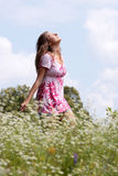 Smile teen open hands standing on field Royalty Free Stock Image