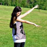 Smile teen open hands standing on the meadow stock images