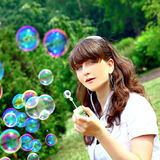 Smile teen with soap bubbles Stock Photos