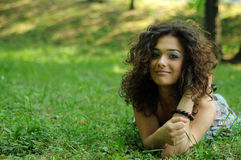 Smile teen standing on field Stock Photography