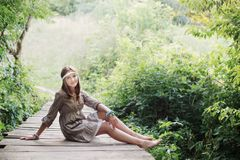 Smile teenager girl on old wooden bridge Stock Photo