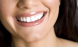 Smile and teeth. Pretty white teeth and beautiful smile of brunette Royalty Free Stock Image