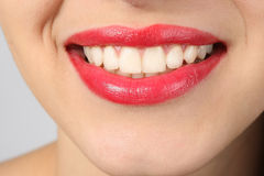 Smile with teeth. Beautiful lips with a smile and white teeth Stock Images