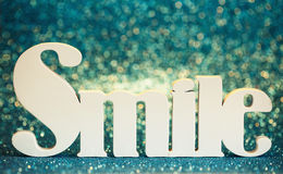 Smile text on brilliant cyan background Royalty Free Stock Photos
