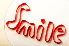 Smile text made with quilling technique close-up studio shot Stock Image