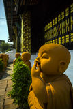 A smile, Thailand. A clay figure of the monk Royalty Free Stock Photos