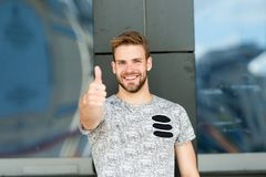 Smile and thumbs up. Handsome guy smiling and gesturing thumbs up. Happy man in casual style extending hand with thumbs royalty free stock photos