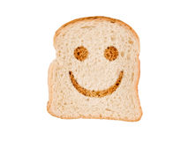 A smile toasted on a slice of bread, isolated on white Stock Images
