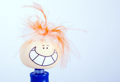 Smile toy face, happy ,smiling faces , funny. Down hair ,big  smile, blue body ,toy with small eyes ,orange hair ,white hair toy , yellow face ,big teeths Royalty Free Stock Photos