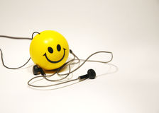 Smile toy with the headphones Royalty Free Stock Image