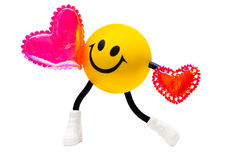 Smile with two hearts. Yellow smile with two hearts Stock Images