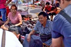 Smile of the vendor Stock Photos