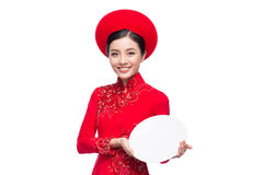 Smile Vietnamese woman in dress traditional Ao Dai and introduce Stock Photography