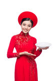 Smile Vietnamese woman in dress traditional Ao Dai and introduce Royalty Free Stock Photography