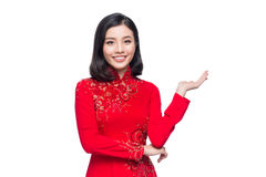 Smile Vietnamese woman in dress traditional Ao Dai and introduce. On white background Stock Photography