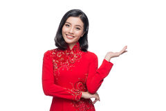 Smile Vietnamese woman in dress traditional Ao Dai and introduce Stock Image