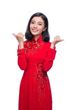 Smile Vietnamese woman in dress traditional Ao Dai and introduce Royalty Free Stock Images