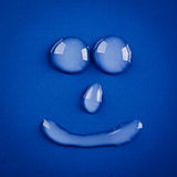 Smile water drops Royalty Free Stock Photography
