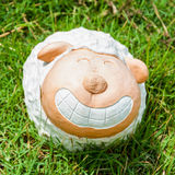 Smile white sheep statue in green grass Stock Image