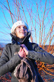 Smile in winter sun. Beautiful young woman smiling at winter sun Stock Photo
