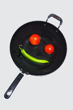 A smile Wok. A smile constituted by Wok tomatoes and green pepper Stock Image