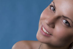 A smile of a woman. With blue eyes and beautiful face Royalty Free Stock Photos