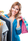 Smile woman in boutigue with shopping bags Stock Images