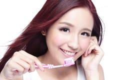 Smile woman brush teeth Stock Images