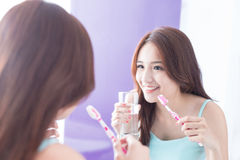 Smile woman brush teeth. Close up of Smile woman brush teeth and look mirror. great for health dental care concept. asian beauty royalty free stock images