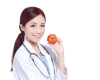 Smile woman doctor hold tomato Royalty Free Stock Images
