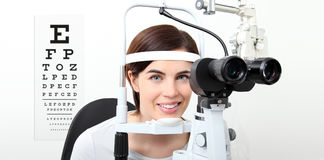 Smile woman doing eyesight measurement with slit lamp and visual Royalty Free Stock Image