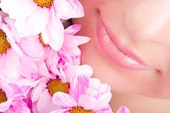 Smile of woman with flowers Stock Photos