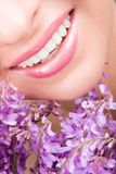 Smile of woman with flowers Royalty Free Stock Photos