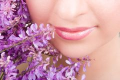 Smile of woman with flowers Stock Images