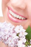 Smile of woman with flowers Stock Photo