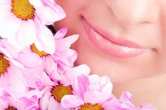 Smile of woman with flowers Royalty Free Stock Images